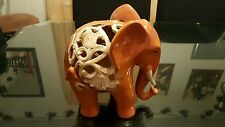 "Porcelain Elephant Figurine With Ornate piercing Cut Outs.9 1/2"" H × 8 1/2"" W."