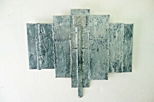 spannendes, informelles Wandobjekt aus massiven Stahlplatten geschweißt