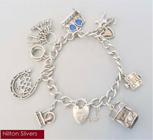 Vintage 6.5'' solid silver charm bracelet w.8 charms - B'ham 1976 (34.59g)
