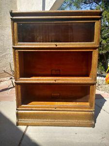 "47"" three section Oak Globe Wernicke Bookcase."