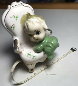 RARE Antique Porcelain Tape Measure: Baby Climbing A Chair.Pre-1920's.Pre-owned.
