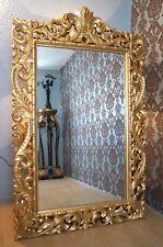 Miroir imposant sculpte à main bois massif doré à la feuille d'or d'un château