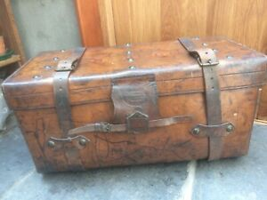 Edwardian Leather trunk 2 buckled straps. Fisher, Strand, London with key.