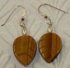 HAND MADE STERLING SILVER EARRINGS WITH NATURAL CARVED TIGERS EYE GEM NC