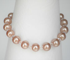 """Champagne gold 8mm glass pearl and clear bead bracelet 7.5"""" with 1.5"""" extender"""