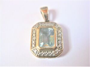 Pendant Gold 333 With Blue Topaz And Diamonds, 2,25 G