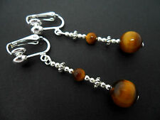 A PAIR OF PRETTY TIGERS EYE SILVER PLATED CLIP ON EARRINGS. NEW.