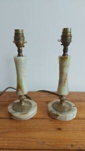 A pair of Antique Onyx candlestick shaped Table Lamps with brass details