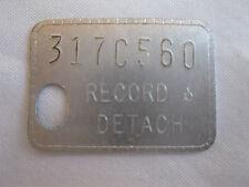 Vintage Record & Detach Tag Token 317C560