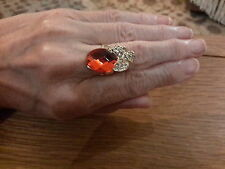 Brand new gold adjustable ring with a bright red crystal and gift box