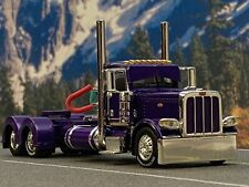 1/64 DCP PURPLE PETERBILT 389 DAY CAB