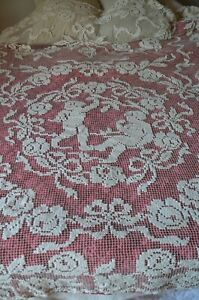 Antique French hand knotted figural lace bed cover, cherubs, ribbon cartouche