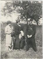 1920s Policeman in Field Laughs with Stern Ladies Snapshot