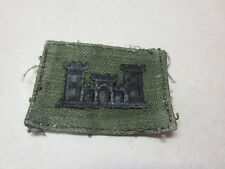 Military patch with what looks like a castle drab green with black stitchiing