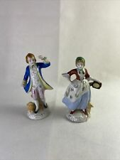 2 Porcelain figures lady and gentleman with dogs Made in Occupied Japan
