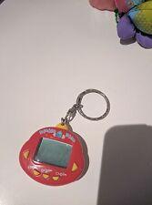 Original RakuRaku DinoKun Dinkie Dino Electronic Virtual Pet (Red)