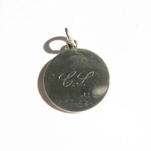 Antique love token charm initials engraved on an old coin