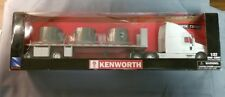 NewRay #13983 Kenworth T2000 with spread axle flatbed. 1/32nd scale.