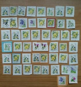 FIFTY IRELAND FLOWER STAMPS ALL USED AND FRANKED ON PAPER - VARIOUS VALUES