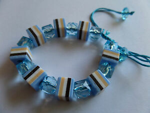 BLUE SWEETIE STRIPED ALL SORT BEAD CORD BRACELET new in gift pouch