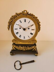 Small English mantle clock Bronze and Gilt case originally fusee now French mvmt