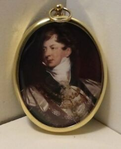 Miniature of King George IV in ceremonial robes in an oval brass frame