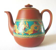 Terra cotta teapot with Pratt-ware decoration