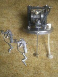 Graco dual transfer pump with agitator and 2 5000 psi Graco silver plus guns.