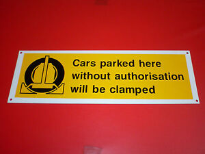 WHEEL CLAMPING private car parking sign 300 x 100 PRE DRILLED plastic.  no