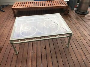Iron made coffee table with glass beveled edges