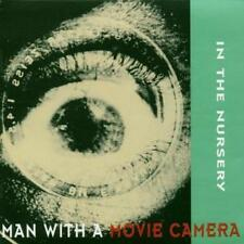 In the Nursery-Man with a movie camera