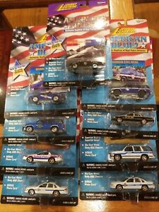 Lot of 9 Johnny Lightning AMERICA'S FINEST/Blue! POLICE VEHICLES REPLICAS