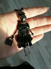 Black doll with dress pendant necklace