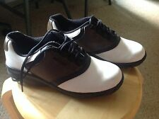 Used Women's size 6M  Footjoy Golf Saddle Shoes, brown,black and white. Nice!