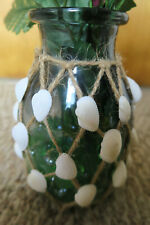 Artificial Flowers With Green Glass And Rope With Seashells