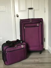 DELSEY 2 PIECE LUGGAGE SET IN PURPLE ROLLING CARRY ON AND 30 IN SPINNER SUITCAS