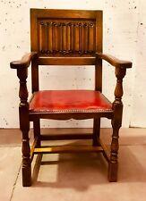 fauteuils en chêne massif  dossier plis de serviette assise cuir . XX siècle.