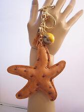 Schlüsselanhänger Taschen Anhänger See Stern Quaste Perle Gold Cognac Kunstleder