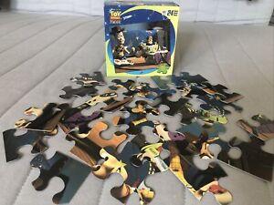 "Disney Pixar Toy Story 24 Piece Puzzle Woody & Buzz Playing 'PlayStation' 10x13"""