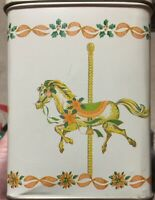 A decorative white tin with carousel horse on each side; #carousel lovers