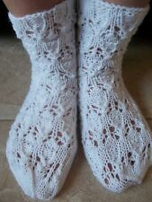 Hand knitted lace pattern socks, snow white