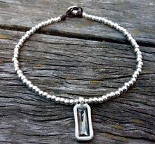 1e8e36c9f2ae collar de cuero zamak con cristal gris tienda 50 y uno