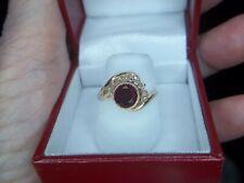 14K  GARNET AND DIAMOND RING.. SZ 6.25