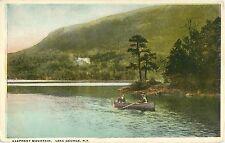 Elephant Mountain, Young Couple Canoeing On Lake George Ny