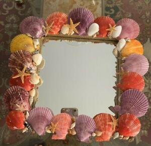 Handmade Purple, red, and yellow Seashell mirror