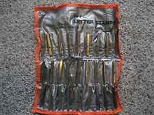 28 letter stamps on pouches a-z and &