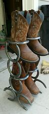 Horseshoe boot rack hold two pairs of boots.