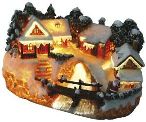 Beleuchtetes Weihnachtsdorf mit Brücke Fiberoptik Weihnachtshaus Weihnachtsmann