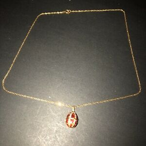 Joan Rivers Gold Tone Chain With Red Enamel And White Crystal Egg