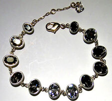 AUTHENTIC SWAROVSKI CRYSTAL GOLD PLATED BRACELET WITH LIGHT TOPAZ/CLEAR CRYSTALS